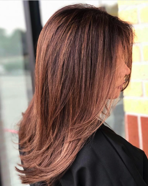 Copper hair color done at Salon Armandeus Katy Texas